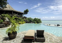 Beautiful beach front bungalow with a crystal clear pool and sunny weather and sun beds