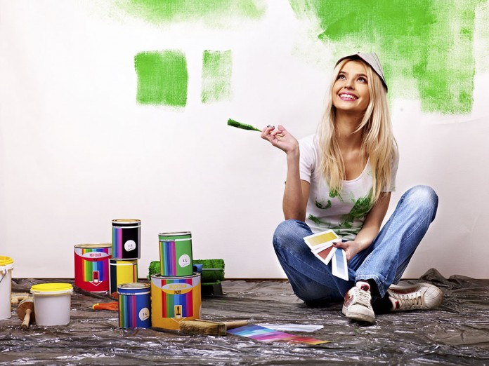Image result for happy woman painting her walls