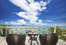 Terrace lounge with rattan armchairs and seaview in a luxury property.Thailand-Property.com