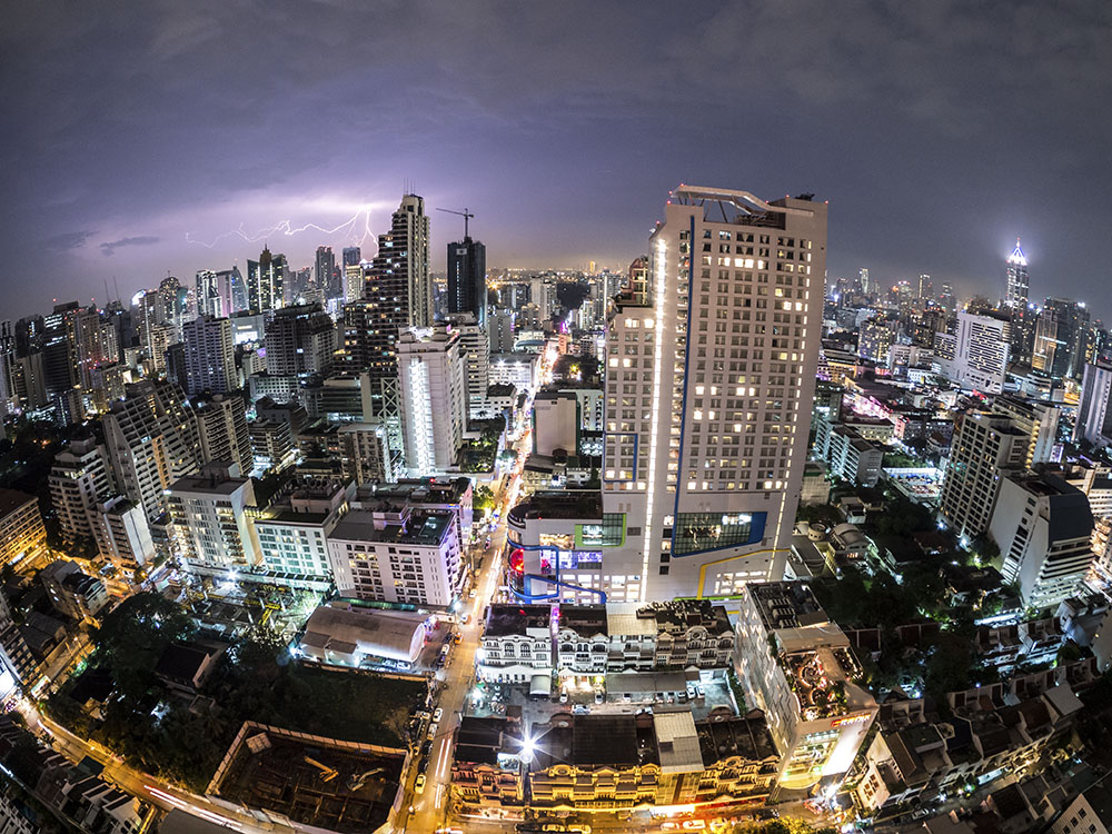 Thunderstorm View over Bangkok City Skyline in Thailand, Asia with Lightning and Street Traffic at Night in Sukhumvit Street.Thailand-Property.com