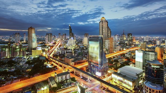 Bangkok Cityscape at twilight, The traffic in the city (Thailand).Thailand-Property.com