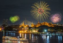 Grand palace and cruise ship in night with New Years fireworks. Thailand-Property.com