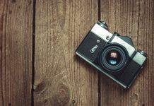 Vintage Camera On Wooden Background