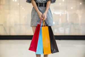 woman-with-shopping-bags-300x200