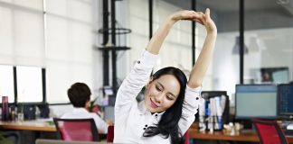 Woman stretching in her office
